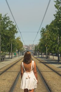 Girl wandering by the tram tracks