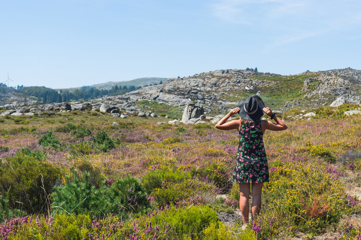 Girl in the flowers at Alvao Natural Park in Portugal