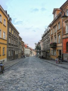 Warsaw Old Town Street, father and daughter riding bicycles