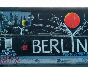 Street art over the historic remains of the Berlin Wall