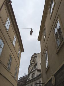 Seven Foot Sigmund Freud hanging over a street in Prague
