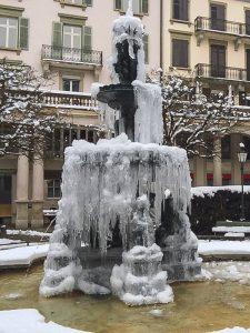 Frozen fountain in cold wintery Zurich Switzerland