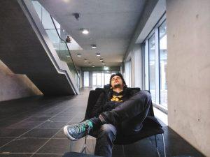 Rui charging batteries and sleeping in a museum in Berlin