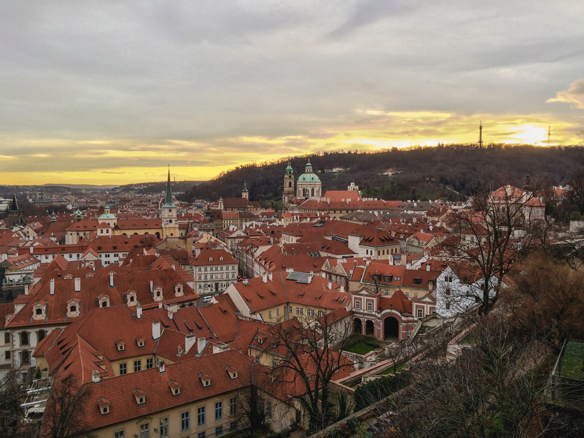 Sunset over the infinite redroofs of Prague