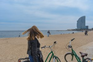 Stopping our bikes for a second to appreciate the beach air in Barcelona
