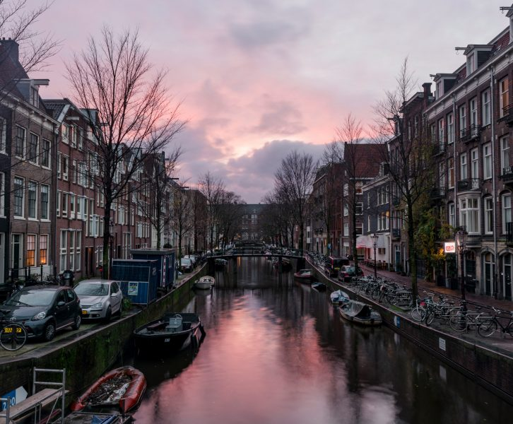 In the city of Amsterdam sunsets by the canals can be very magical