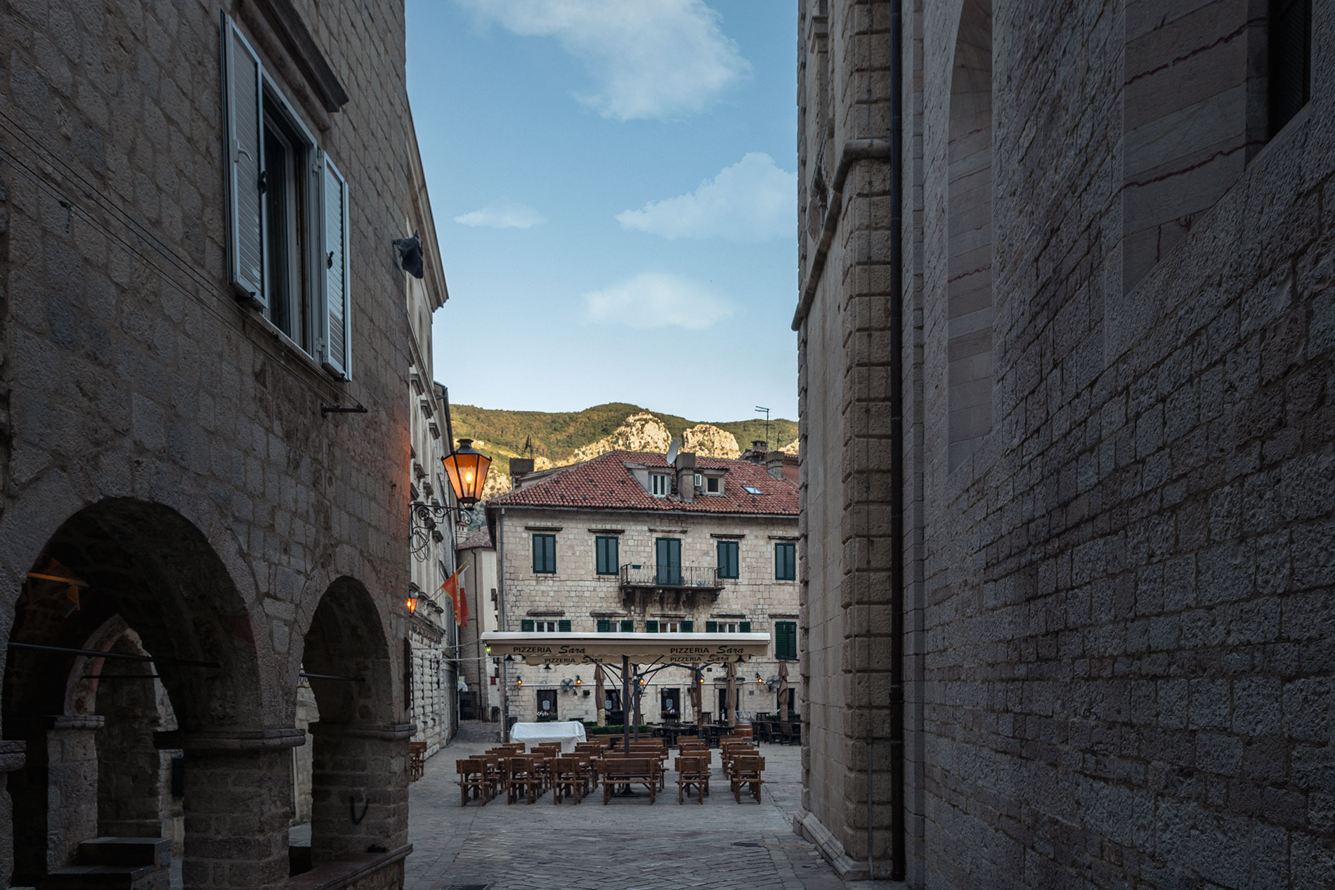 During the early morning the streets of Kotor are empty and the city seems like an open-air museum