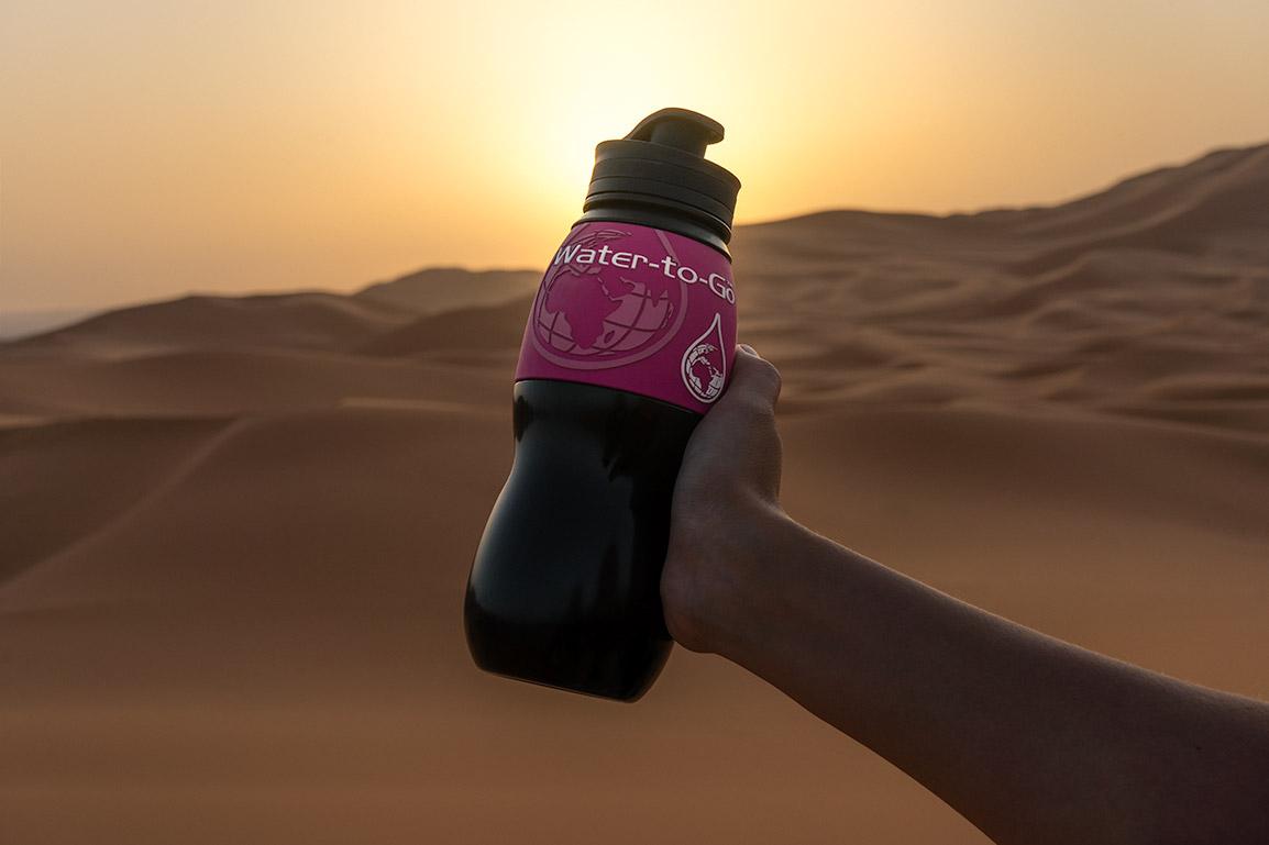 Water to Go bottle in the desert