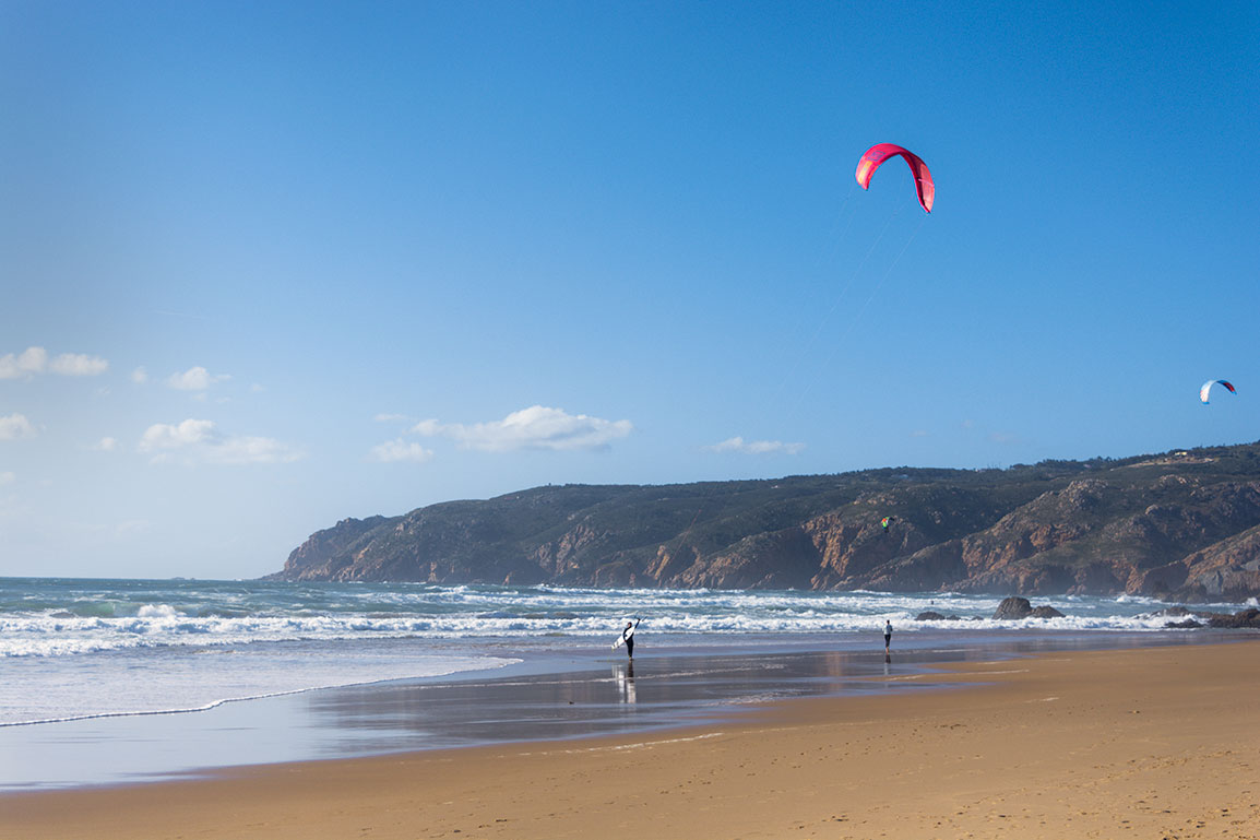 Praia do Guincho, near Lisbon: two men kitesurfing