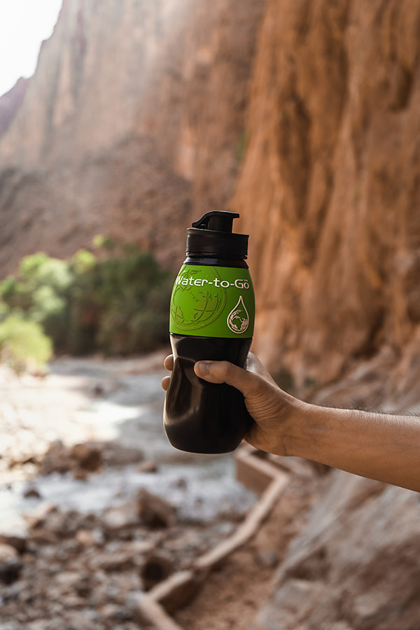 A green Water-to-Go bottle