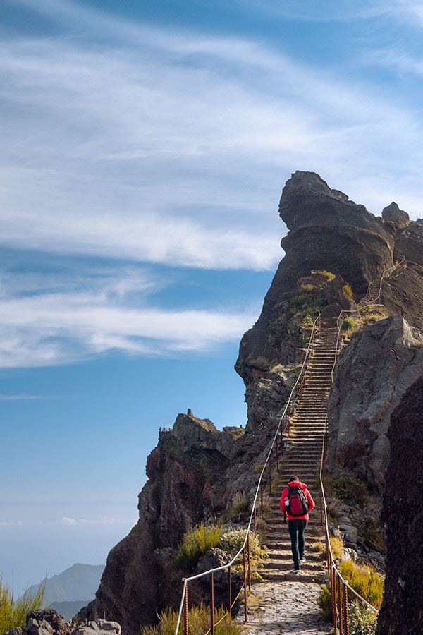 Rui climbing a steep stairway in the PR1 hike in Madeira to Pico Ruivo
