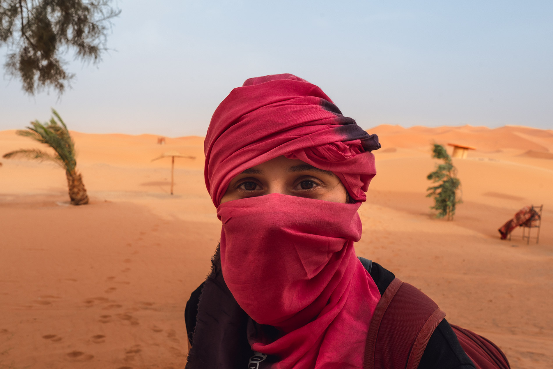 Maria with her head scarf in the Moroccan desert