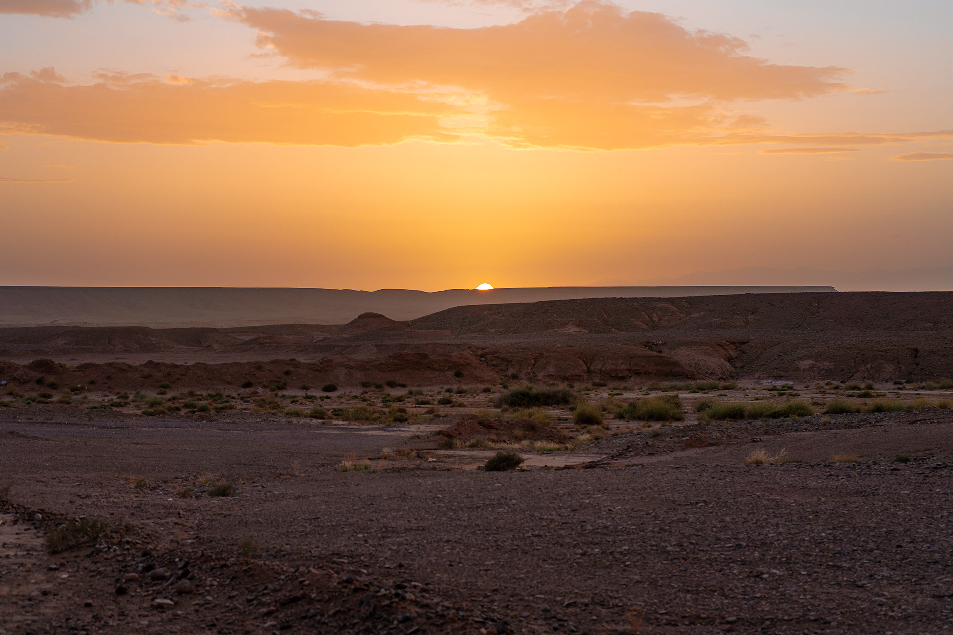 An orange sunset to end our desert tour in Morocco